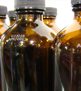 White Inkjet Coding on Amber Bottles